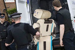 The confused.com robot being taken into custody earlier today, yesterday