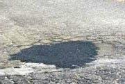 The fixed pothole, yesterday